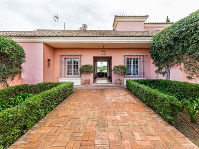 Photo for Andalusian Villa in guarded urbanization, ideal for golfers