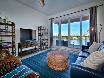 Large flat screen TV and view of the water.