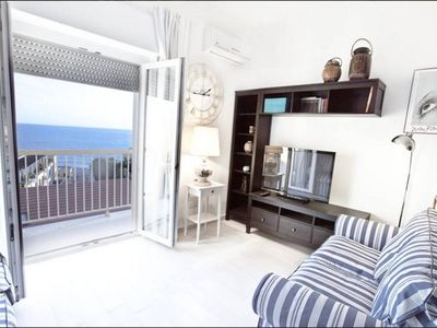 Photo for Bright attic with amazing sea views in the center of Alghero with AC and WiFi
