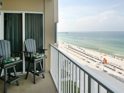 Photo for Deluxe, beachfront escape w/ a furnished balcony, shared pools, hot tub, & gym