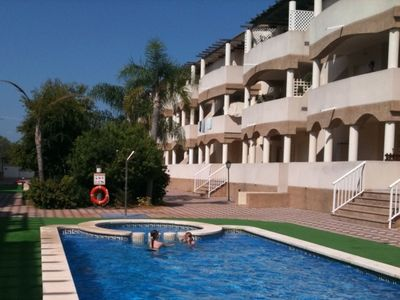Photo for 3 BEDROOM LUXURY PENTHOUSE, BEACH & GOLF & POOL, WIFI, Large TV/SATELLITE, GARAG