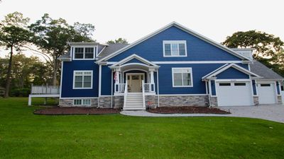 Photo for Gorgeous new 7bdrm  5.5 bath home, across from park, 2 blocks to beach