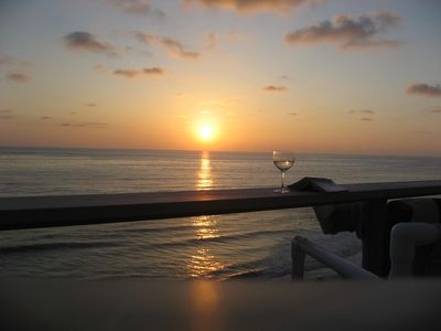 Balcony sunset reading a good book and glass of wine?