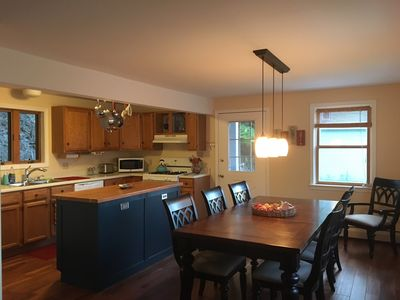 Large, stocked kitchen with cherry island and dining for 8