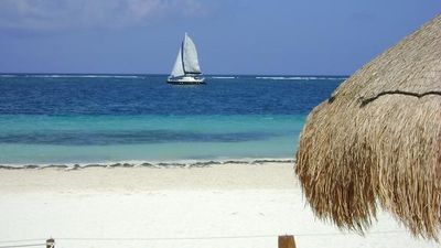 Beachfront at Casita Blanca.  Private palapas provide shade on our beachfront.