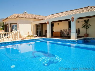 Photo for Popular villa with pool, jacuzzi, air-con and WIFI, Short drive to sea, just outside Estepona town