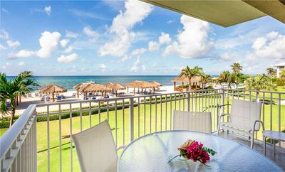 Photo for Dazzling ocean views from this stylish, 3-bedroom condo on Seven Mile Beach