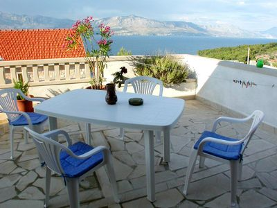 Photo for Two bedroom apartment with terrace and sea view Postira, Brač (A-2919-b)