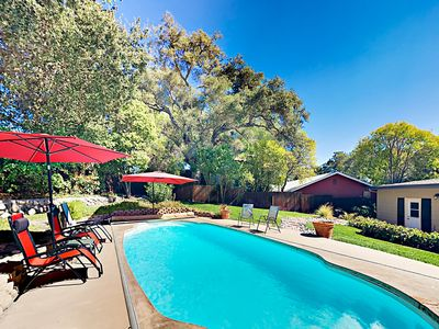 Pool - Choose sun or shade for your poolside relaxation in the private backyard.