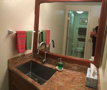 Large, deep stainless steel sink/ granite counter top/ Cherry wood cabinets.