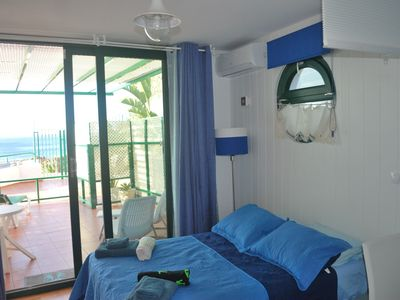 Photo for Studio apartment right on the harbor with great sea views