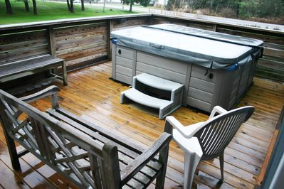 Private outdoor hot tub operates year round