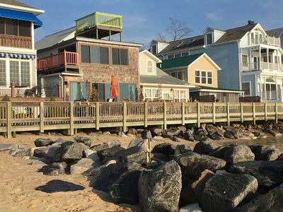 From the beach, Brown house with cedar shake shingles and green deck on top