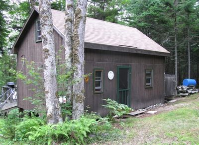 Dog-friendly, rustic cabin on secluded, pristine lake, North Coast of Maine.