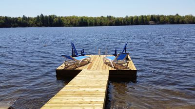 Dock including lounge and muskoka chairs