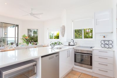 Galley kitchen overlooking Moreton Bay as you cook