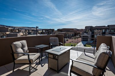 Upstairs Patio Fire Pit, Furniture & View - Stay warm next to the fire pit and relax while watching the sunset over the red mountains.