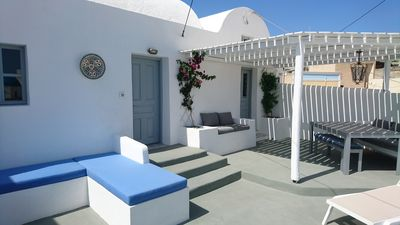 Main courtyard with dining area, seating and sun loungers