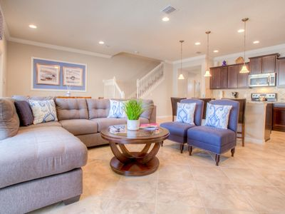 Photo for Popular 5 BR townhome with pool in new resort 10 minutes from Disney World!