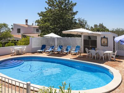 Photo for Luxury Villa, Walk to town & beach, heated safe pool gated, Free Wifi and Air Co