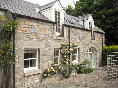 Photo for THE COACH HOUSE, pet friendly, with open fire in Lowick, Ref 1979