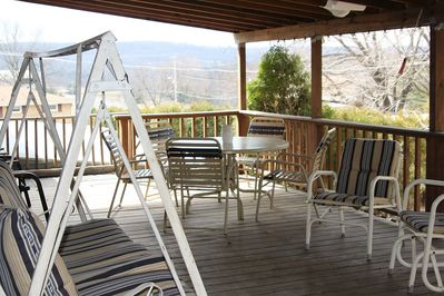 large covered deck with plenty of seating to have a family gathering