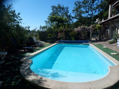 Photo for Pleasant house in the middle of oaks with swimming pool. At the foot of the Cévennes.