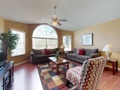 Photo for NEW LISTING! Bright & fun condo w/ two shared pools & hot tubs - near Disney!