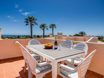 Photo for Stunning 2 bedroom south facing linked villa with communal pool and sea views