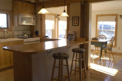 Kitchen with View Into Sunroom