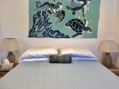 Bedroom 2: king bed w batik turtle print hanging