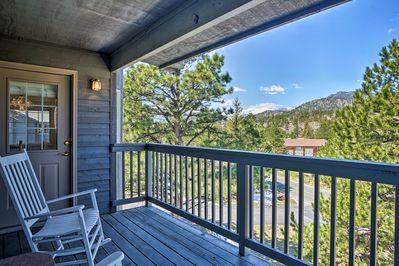 This condo boasts a private balcony and beautiful mountain views!
