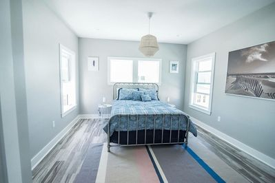 Guest room upstairs with queen bed with private full bathroom.