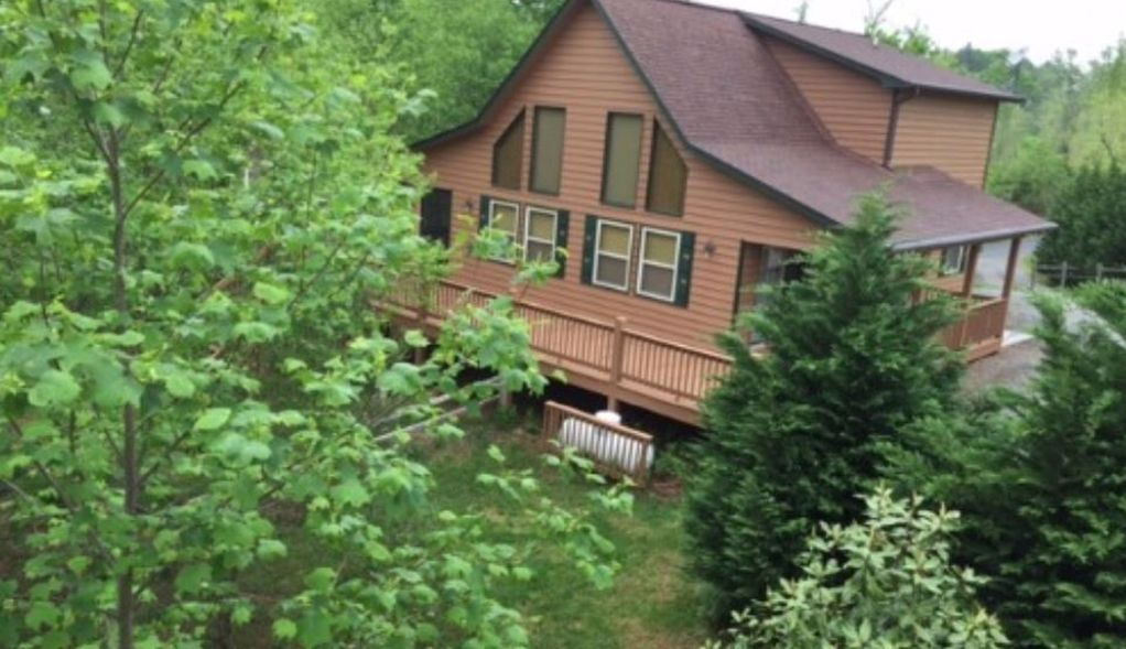 bedroom in pigeon gatlinburg the forge cabin rental top rentals and luxurious with log a smoky bear teddy queen cabins mountain luxury bed