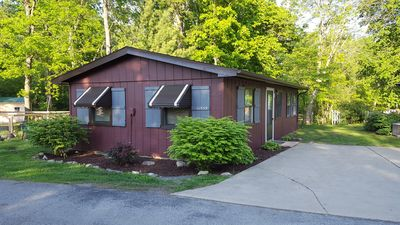 Photo for Sweet Cottage in Private Family Resort with Beach, Pool and Lake Freeman Access
