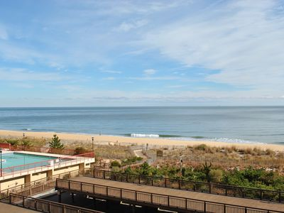 Photo for Cozy, comfortable 2 bedroom oceanfront condo perfect for large families with free WiFi, an indoor pool, and a deluxe balcony with a great ocean view located uptown and steps to the beach!