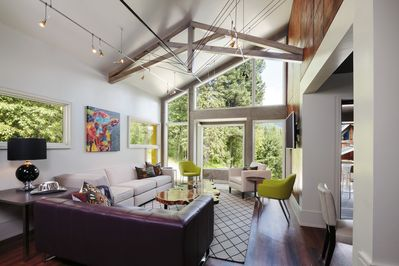 Spacious Living Area with freestanding linear fireplace and mountain views