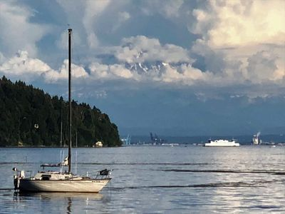 View of Vashon, Commencement Bay and a cloudy view of Mt Rainier from the beach.
