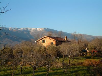 South side of house and Gredos mountains in winter