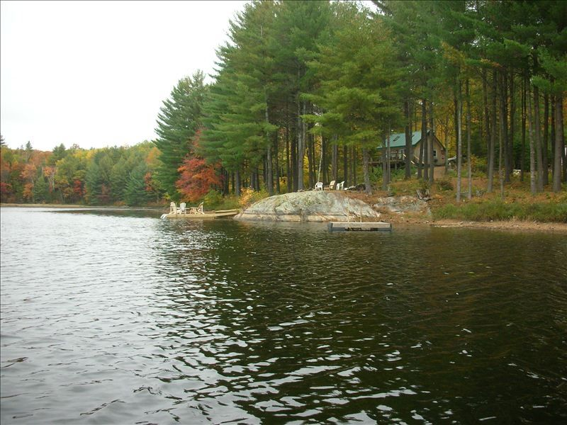 Secluded cabin on your own private lake nes vrbo for Cottages in the lakes with swimming pools