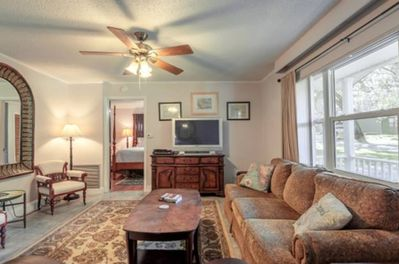 Large comfortable living room with satellite tv and a wide assortment of dvds.