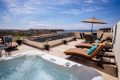 Relax in your jacuzzi on your private rooftop deck viewing the beach.