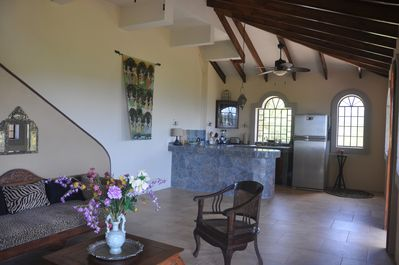 open living room and kitchen flowing on to covered veranda