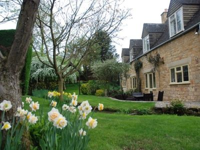 Photo for Beautiful Cotswold Mill Cottage being dog friendly with garden and stream