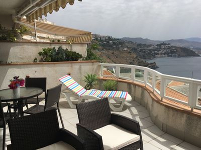 Photo for Bright and quiet apartment with stunning views over the coastline of Granada