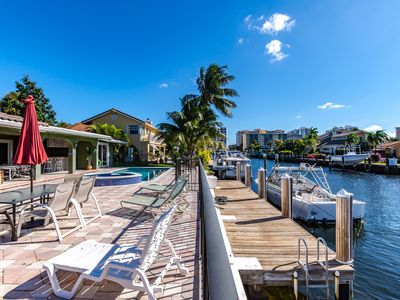 Photo for Heated pool and jacuzzi on the water, close to the beach, restaurants and bars.