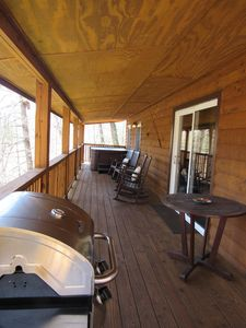 Back deck with gas grill and propane tank provided