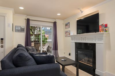 The living room also includes a comfortable queen-sized sleeper sofa.