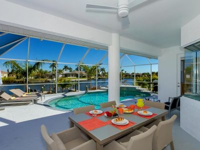 Photo for SW Cape Coral | Gulf Access | Desirable Surfside area, clean modern decor and priceless water views