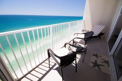 Balcony seating, views off of  LR and MBR,  1 Lounger, 2 chairs, side table